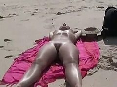 Hidden cam woman on beach