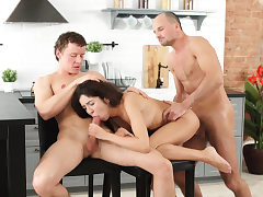 Cute dark haired Katty has a steamy threesome in the kitchen