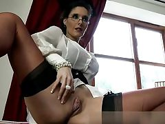 Horny mistress is unsheathing her boobs and twat ready to fuck
