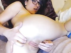 Super-sexy female is vibing her both holes finger-tickling them seductively