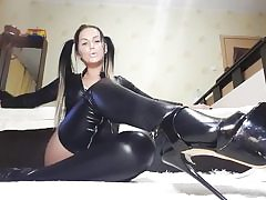 Hot superslut on high heels and leather costume fumbling her kinky coochie hole