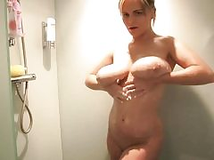 Blond beauty with huge jugs takes a sensual shower all alone