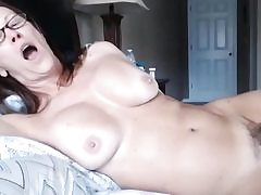 Milf nymph laying on sofa exposing her immensely furry pussy crevasse