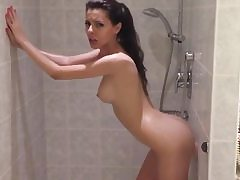 Really super-steamy woman is taking douche and is fucking her cunny with dildo