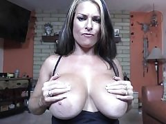 Slutty super-bitch gobbling a huge dick and then she titty fucks the boner