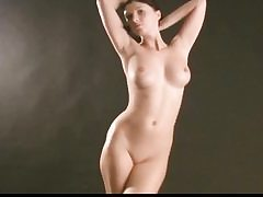 Splendid nude honey is posing on sex tape covering her assets in grease