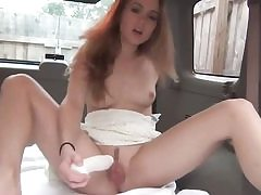 Teen slut is playing with her vag in her van filling up her cunt